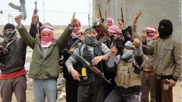 Iraqi men from local tribes brandish their weapons as they pose for a photograph in the city of Falluja, west of the capital Baghdad, on January 5, 2014.