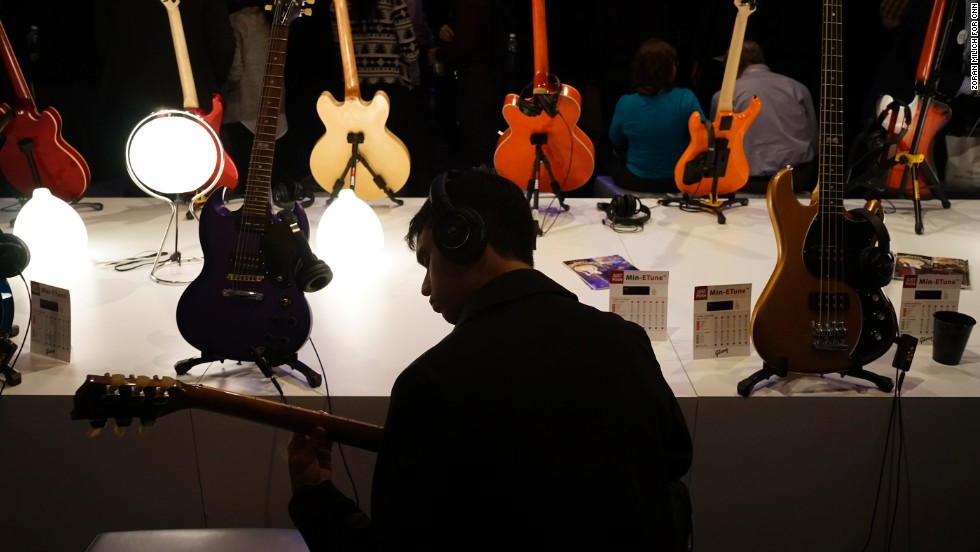 A man jams out at the Gibson tent at CES.