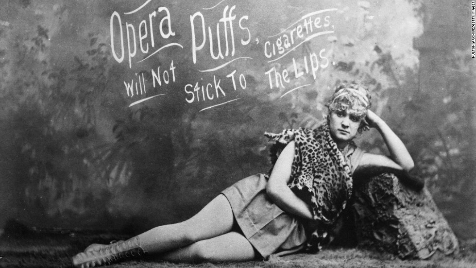 A model is seen lying down in an advertisement for Opera Puffs Cigarettes.