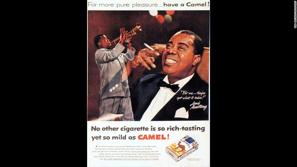 Jazz legend Louis Armstrong appears in an advertisement for Camel cigarettes.