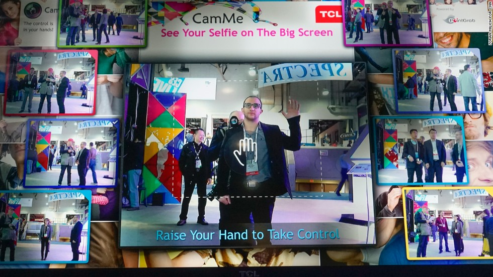 Pointgrab uses a big-screen monitor to demonstrate CamME, a hands free selfie application.  The application lets you use hand gestures to trigger your phone's camera.