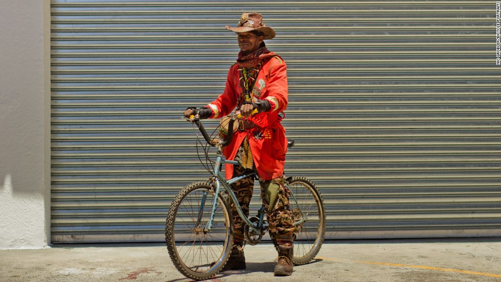 """""""The bike is for me to do the work of selling some medicines, you see. I travel with the bike to get some herbs and medicines on the mountains. I do healing of the people and selling medicines -- for a living. I pick up some plants in the mountains, so I'm heading to the mountains now -- it's the usual work I do."""""""