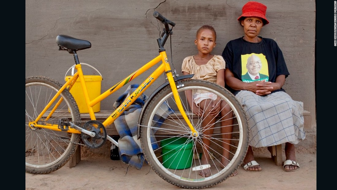 "Dibuseng, pictured with her mother, Majanki, says: ""The bicycles were bought by the government for us, so that we can ride them to school, because we travel long distances."""