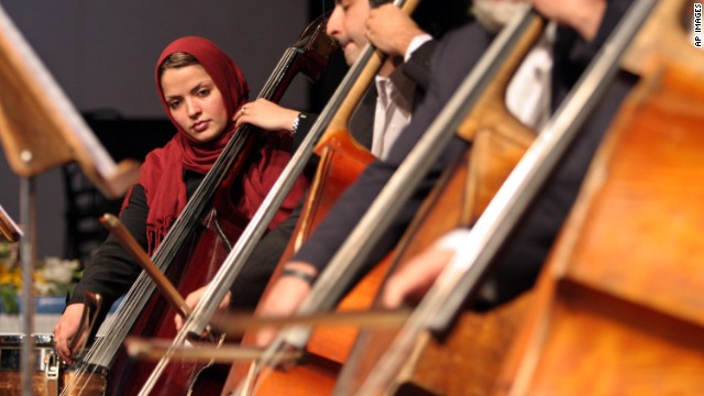 An Iranian female musician, performs, in Iran's National Music Orchestra performance, during Iran's 21st Fajr International Music Festival, in Tehran, Saturday, Jan. 14, 2006.