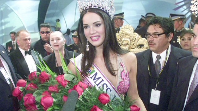 Slain beauty queen's family seeks peace