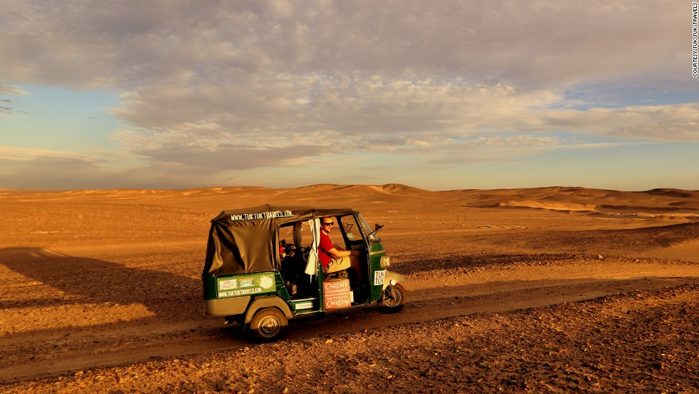 Using makeshift wood planks and spades, Nick Gough and Richard Sears learned how to free their tuk tuk when it got stuck in the sand. Egypt was one of the toughest countries to bring a tuk tuk into, says Gough.