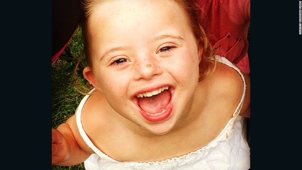 """Ellie Bowerman laughs during a play date with her friends. The 4-year-old has Down syndrome, but """"she's more alike than different,"""" writes her father, Bret Bowerman."""