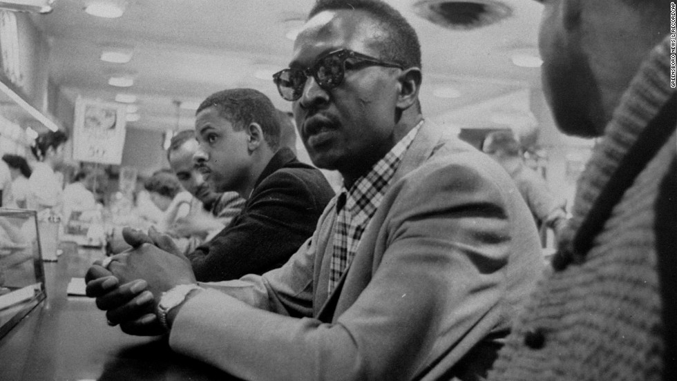 "<a href=""http://www.cnn.com/2014/01/10/us/greensboro-four-activist-obit/index.html"" target=""_blank"">Franklin McCain</a>, seen center wearing glasses, one of the ""Greensboro Four,"" who made history for their 1960 sit-in at a Greensboro Woolworth's lunch counter, died on January 10 after a brief illness, according to his alma mater, North Carolina A&T State University."
