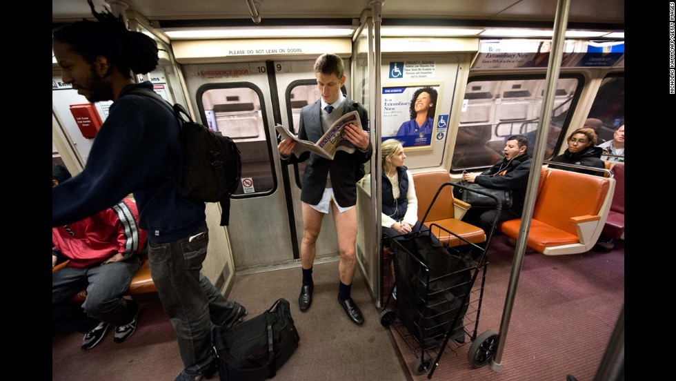A man reads a newspaper in his underwear while riding a Metro train in Washington.