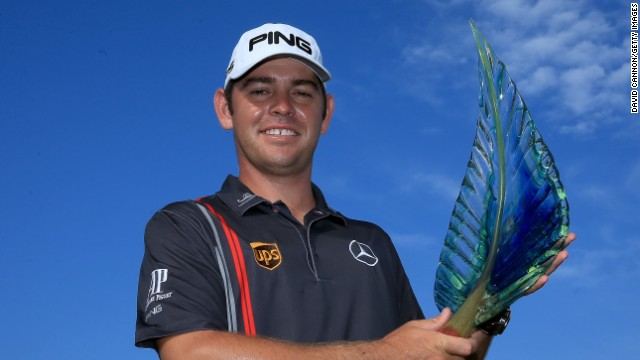 Louis Oosthuzen shows off the winning trophy after the South African won the European Tour event in Durban.