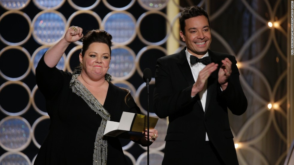 "Melissa McCarthy and Jimmy Fallon present the award for best actor in a miniseries or TV movie. It was won by Michael Douglas for his performance in the HBO movie ""Behind the Candelabra."""