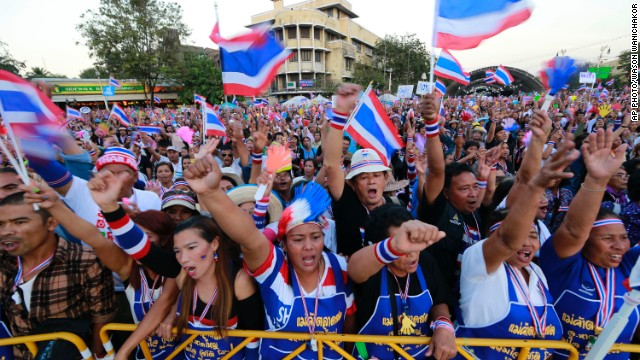 Thai anti-government protesters shout and cheer during a rally at the Democracy Monument in Bangkok, Sunday, January 12, 2014.