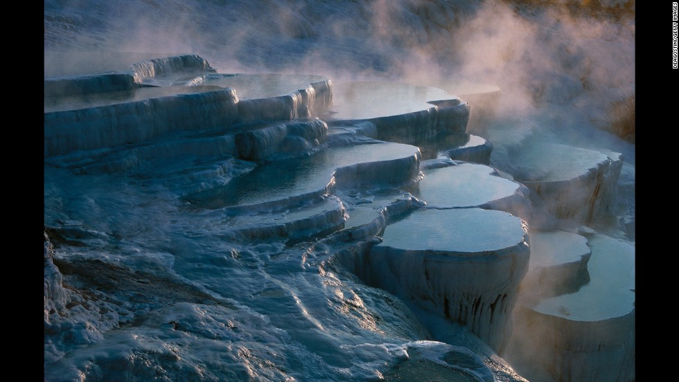The frozen-looking landscape in Pamukkale, Turkey, is actually the result of calcium carbonate deposits from 17 natural hot springs accumulating over thousands of years.