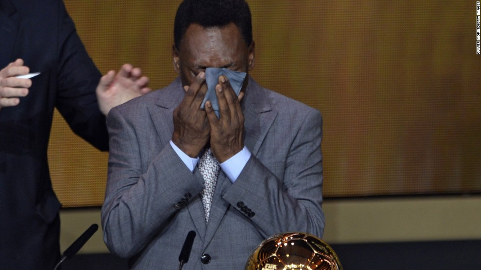 Brazilian legend Pele cries as he is handed an honorary FIFA Ballon d'Or, with the three-time World Cup winner having been ineligible to win the award during his playing days because he did not play in Europe.