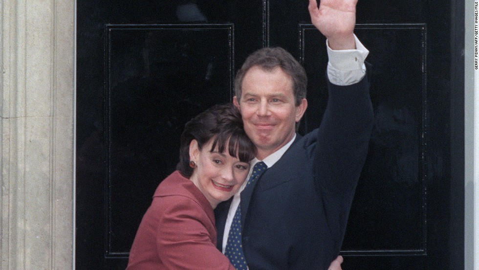 "Blair hugs her husband outside 10 Downing Street on May 2, 1997 following the Labour Party's victory in the country's general election. But Blair tells CNN that when she met a young Tony Blair while training to be a lawyer, he didn't leave a good impression. ""I thought he's just another one of these public school boys but then we worked together and ... he made a different impression on me."""