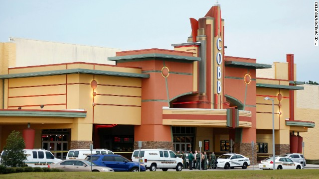 "Police tape surrounds the Cobb Grove 16 movie theater in Wesley Chapel, Florida, on January 13. A moviegoer shot and killed one person and wounded another on Monday when an argument over text messaging in the Florida theater showing the hit new war film ""Lone Survivor"" erupted in gunfire, authorities said."