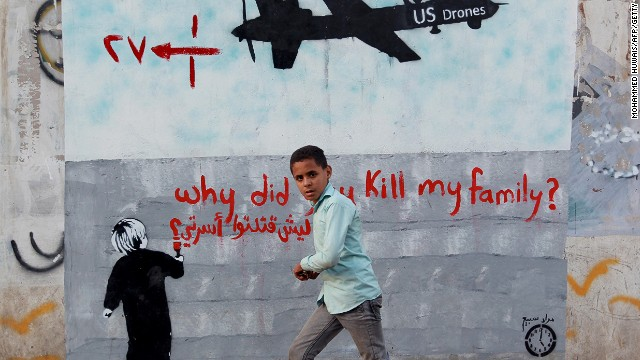 A Yemeni boy walks past a mural of a U.S. drone on December 13, 2013 in the capital Sanaa.