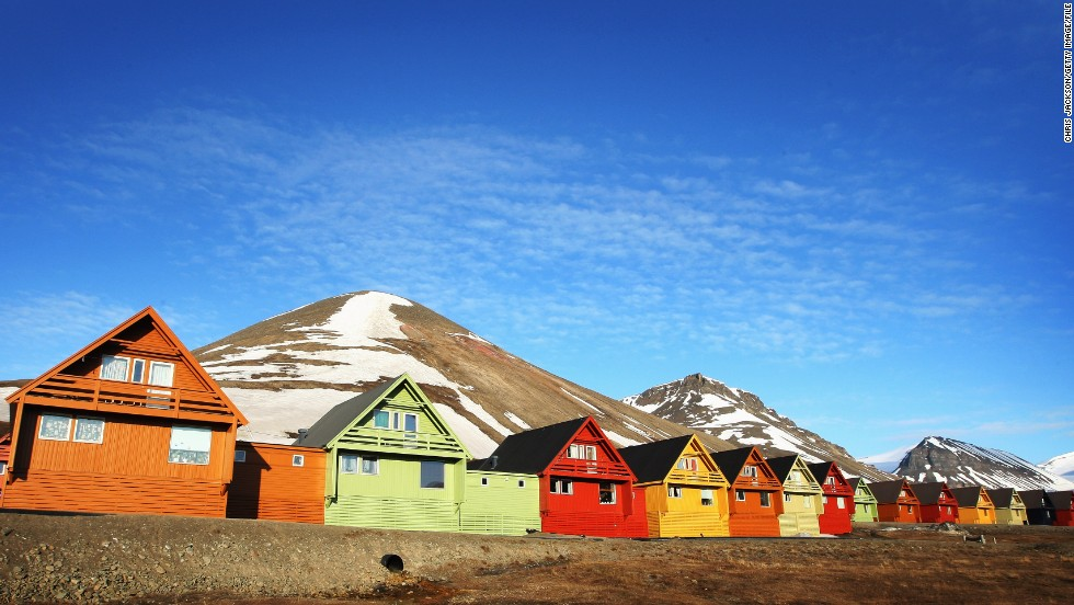 From April 20 to August 23, the sun never sets over Svalbard, a Norwegian archipelago that lies north of Greenland in the Arctic Sea. Here, colorful cabins reflect the midnight sun in June in Longyearbyen, the capital of Svalbard.