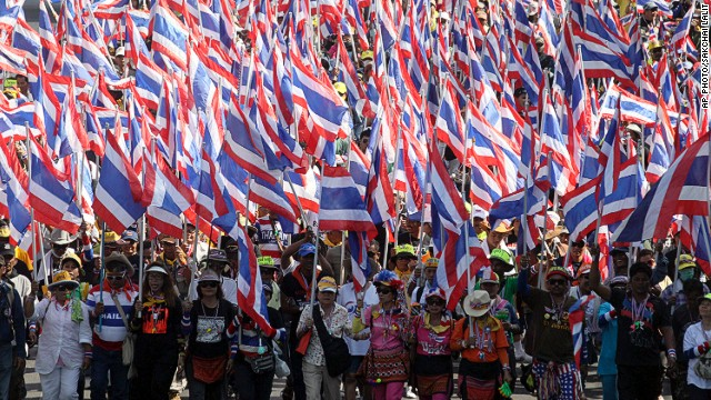Anti-government protesters with national flags gather for a rally Tuesday, Jan. 14, 2014, in Bangkok, Thailand.