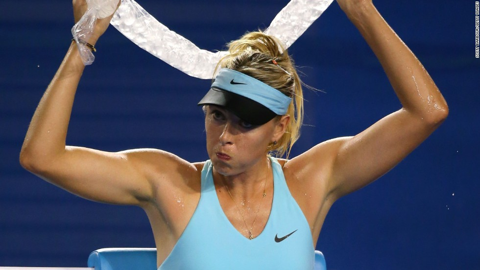 Maria Sharapova wrapped ice around her neck in a bid to keep cool during her first round win over Bethanie Mattek-Sands.