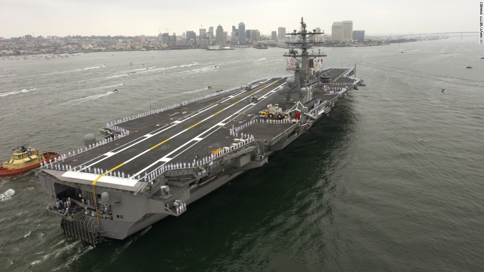The USS Ronald Reagan is a Nimitz-class aircraft carrier. It's almost 1,100 feet long, with a flight deck 252 feet wide and it displaces 97,000 tons.