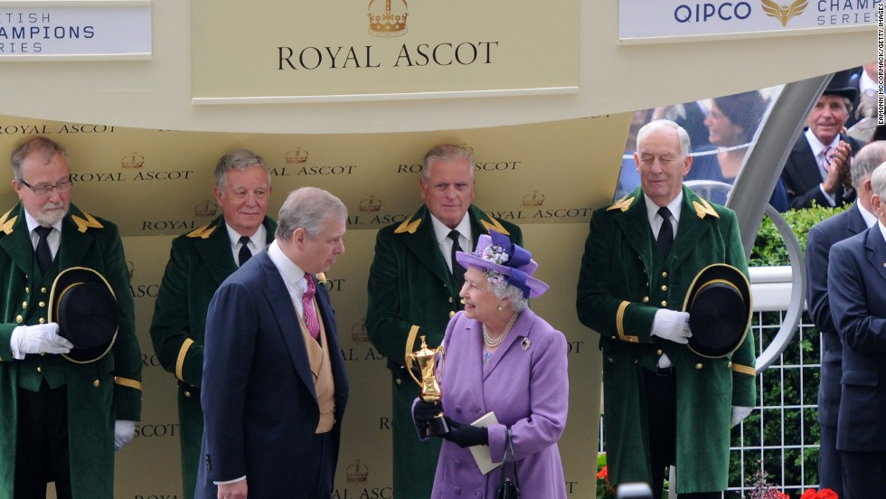 The British monarch receives the winning trophy for the Ascot Gold Cup last year after her horse Estimate won the prestigious race.