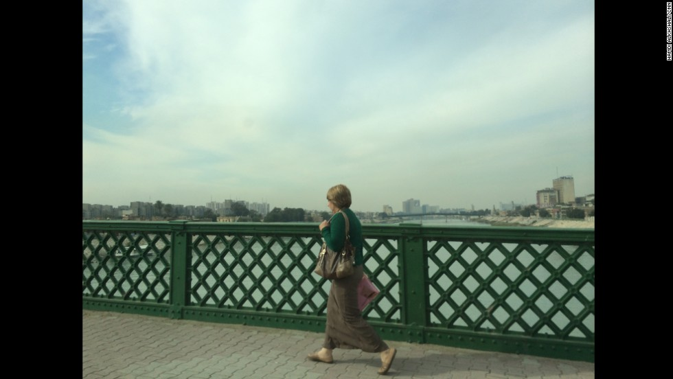 In this image taken on January 15, a woman walks through central Baghdad, Iraq, crossing a bridge over the Tigris River. CNN's Michael Holmes is in the Iraqi capital for the first time in two years. Click through to see images from Holmes and CNN producer Hamdi Alkhshali.