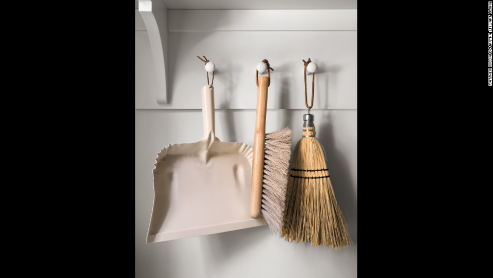 A row of Shaker-style pegs can store necessary tools like brushes and dustpans -- accessibility and visibility make sense when it comes to cleaning and washing.