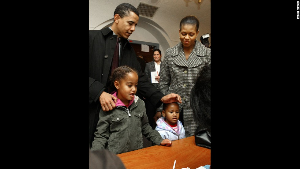 The Obamas check in with poll workers in Chicago in November 2004. Barack Obama would go on to win a U.S. Senate seat.