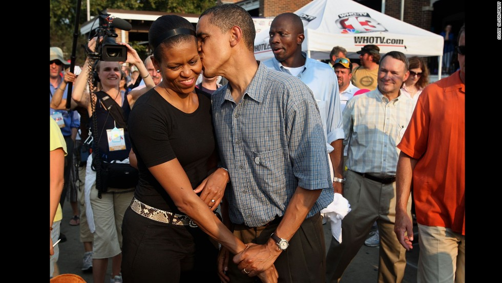 Barack Obama gives his wife a playful kiss as they tour the Iowa State Fair in Des Moines, Iowa, in August 2007. Obama was campaigning at the time for the Democratic presidential nomination.