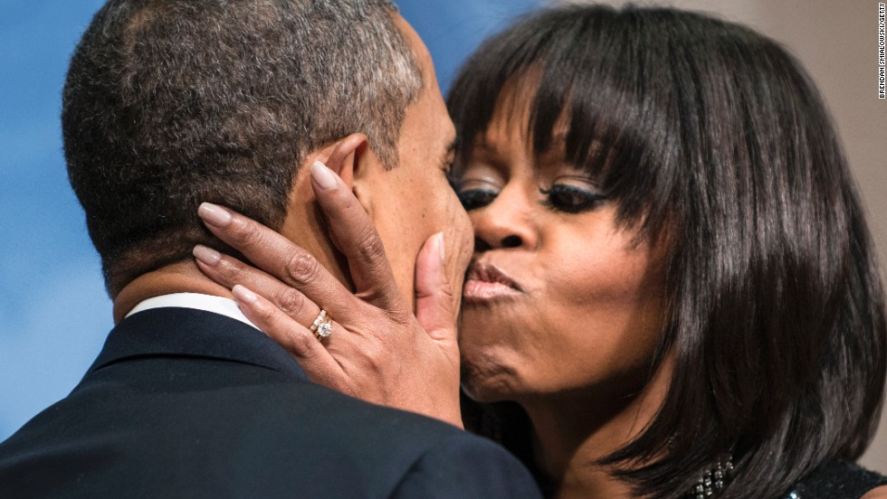 The first lady kisses her husband during an inauguration reception at the National Building Museum in Washington in January 2013.