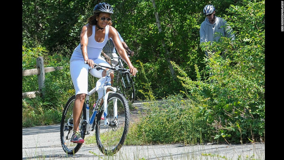 The first lady rides a bike while vacationing in Martha's Vineyard, an island off the coast of Massachusetts, in August.
