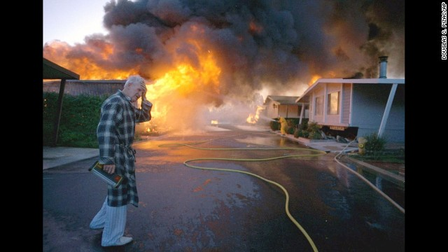 Ray Hudson reacts as a friend's home goes up in flames at the Oak Ridge Trailer Park in Sylmar, Calif., after a major earthquake hit the San Fernando Valley area of Los Angeles in this Jan. 17, 1994, file photo. Ten years later, it's hard to imagine that so many parts of Southern California lay in ruins on Jan. 17, 1994, thousands of its buildings smashed, millions of its people shaken both emotionally and physically, 72 of them killed.  (AP Photo/Douglas C. Pizac, File)