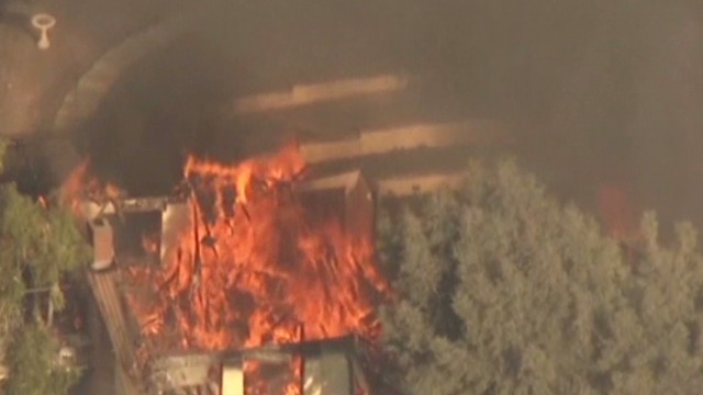 Wildfire devours homes near Los Angeles