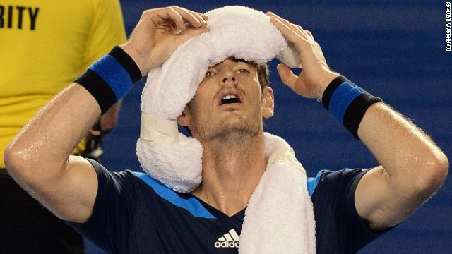 Britain's Andy Murray cools down with an ice towel during his men's singles match against France's Vincent Millot on day four of the 2014 Australian Open tennis tournament in Melbourne on January 16, 2014. IMAGE RESTRICTED TO EDITORIAL USE - STRICTLY NO COMMERCIAL USE AFP PHOTO / MAL FAIRCLOUGHMAL FAIRCLOUGH/AFP/Getty Images