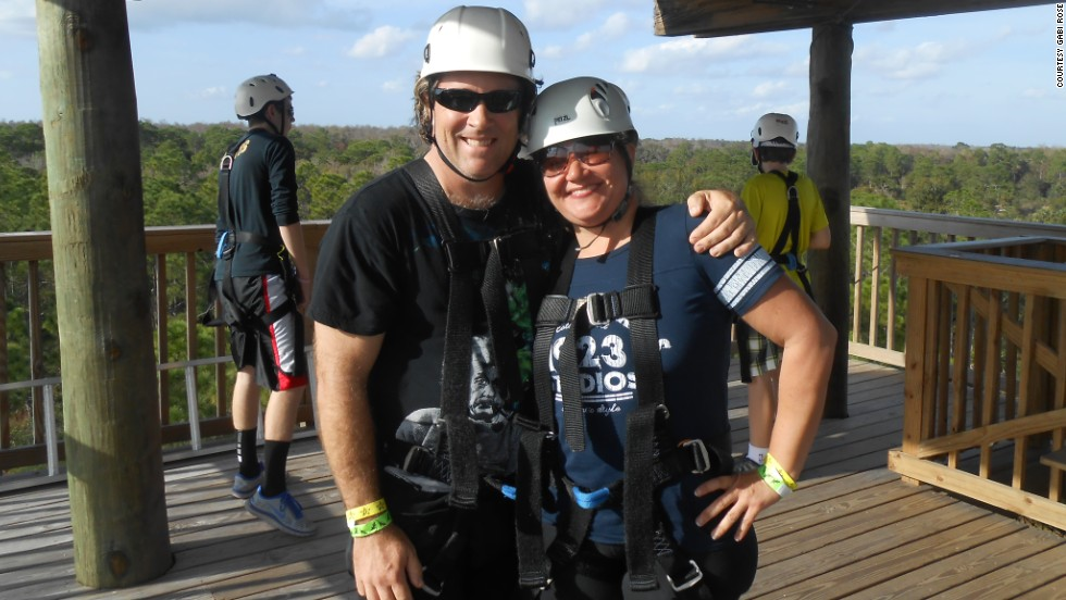 Gabi and David Rose ride a zip-line roller coaster in St. Cloud, Florida, to celebrate their weight loss.