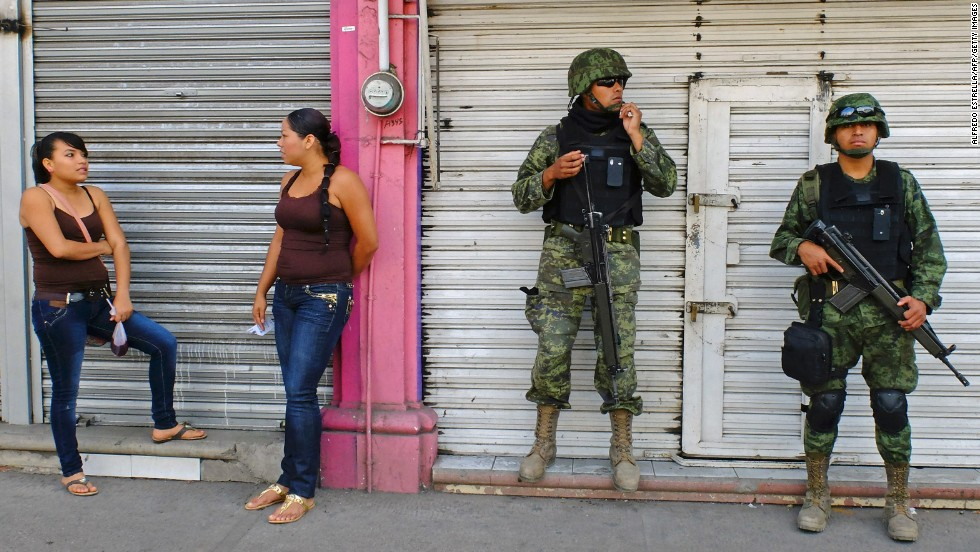 Mexican soldiers patrol the streets of Apatzingan on January 16. The situation with the vigilantes has become a major problem for President Enrique Peña Nieto's government, which has vowed to reduce drug violence.