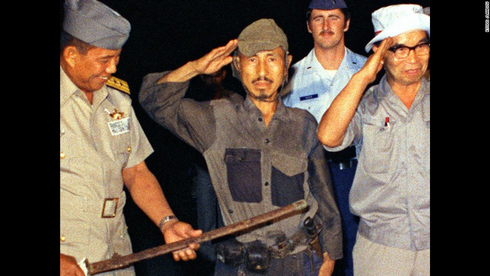 "<a href=""http://www.cnn.com/2014/01/17/world/asia/japan-philippines-ww2-soldier-dies/index.html"">Hiroo Onoda</a>, center, salutes after handing over his military sword on Lubang Island in the Philippines in March 1974. Onoda, a former intelligence officer in the Japanese army, had remained on the island for nearly 30 years, refusing to believe his country had surrendered in World War II. He died at a Tokyo hospital on January 16. He was 91."