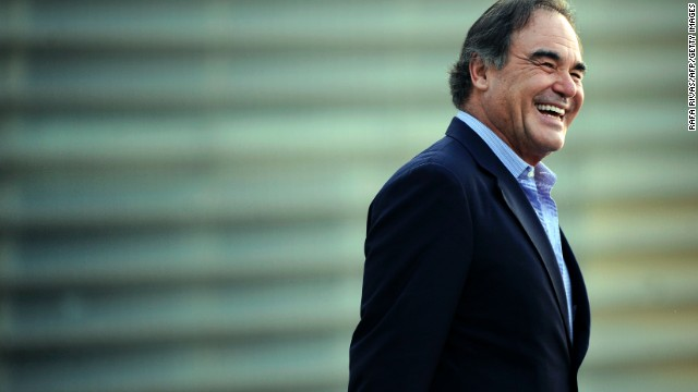 Oliver Stone smiles as he poses during the 61st San Sebastian Film Festival where he has presented his documentary film 'The Untold History of the United States', in the northern Spanish Basque city of San Sebastian on September 24, 2013.
