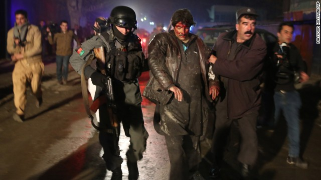 Afghan police forces assist an injured man at the site of an explosion in Kabul, Afghanistan, on Friday, January 17.