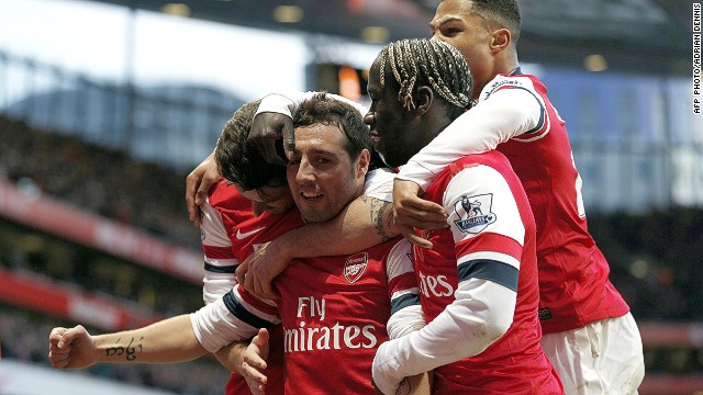 Spanish midfielder Santi Cazorla scores twices to ensure Arsenal hang on to their slim EPL lead.