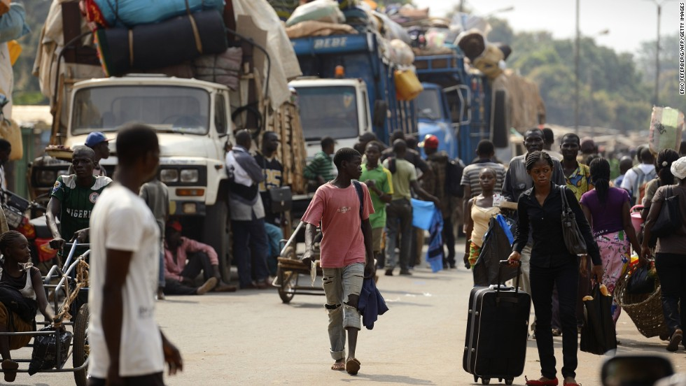 Muslim civilians prepare to board trucks in Bangui to flee the capital on Saturday, January 18.