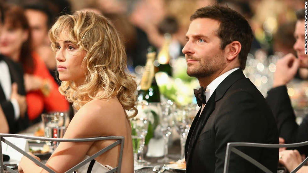 Model Suki Waterhouse and Bradley Cooper sit in the audience.