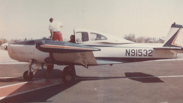 Aero Club of Southern Calfornia attorney Bob Lyon, seated, and his brother Jim are seen in the cockpit of Lyon's Navion aircraft in this undated photo.
