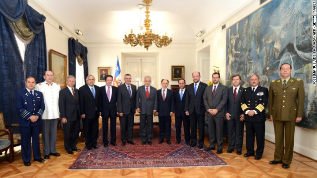 Handout picture released by the Chilean presidency showing Chile's President Sebastian Pinera (C, red tie) posing with members of the National Security Council, including cabinet ministers, the chiefs of the Armed Forces and other authorities, before a meeting to discuss about the maritime dispute with Peru, at La Moneda presidential palace in Santiago, January 20, 2014. The International Court of Justice will deliver its ruling on a long-running maritime boundary dispute between Chile and Peru on January 27. Peru took its neighbor to The Hague in 2008, saying their border in the Pacific Ocean was unclear and accusing Chile of appropriating its territory. Chile insists that the border was settled by two agreements signed in 1952 and 1954 -- treaties that Peru argues were meant to regulate fishing, not demarcate the border.