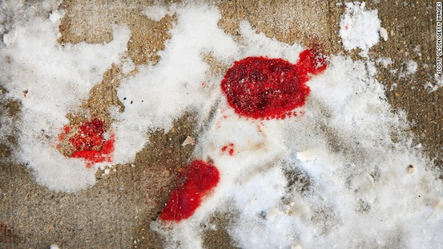 Blood is frozen in snow in Chicago's Logan Square neighborhood after a 68-year-old man was shot to death.