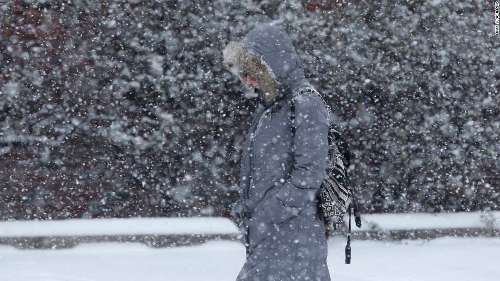 A woman walks through a snow storm on January 21 in south Philadelphia.
