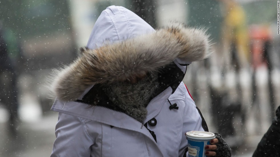 People try to cover up head to toe during frigid conditions in New York on January 21.