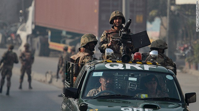 Pakistani army troops secure a road leading to the site of suicide bombing in Rawalpindi, Pakistan on January 20, 2014.