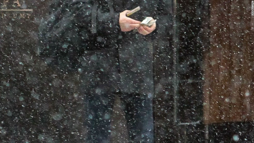 """Vampire Diaries"" star Paul Wesley tries to grab a cab in snowy New York City on January 21."